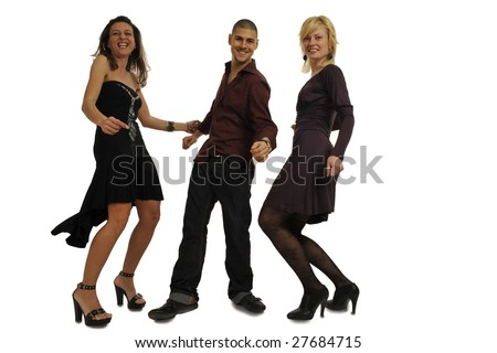 Full body view of two women and a man in chic wear dancing together and having fun at a party. Isolated on white background.