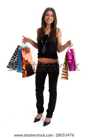 Full body view of young attractive woman going shopping with lots of colorful shopping bags. Isolated on white background.