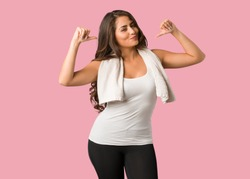 Full body young fitness curvy woman pointing fingers, example to follow