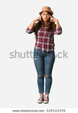 Full body young traveler curvy woman doing a concentration gesture #1241115193