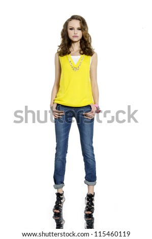 Full body young woman in casual clothes posing for the camera