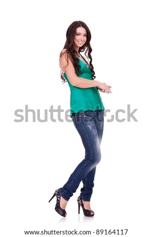 Full body young woman in casual clothes posing for the camera over white