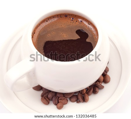 Full cup of black coffee and coffee beans on the saucer, isolated on white