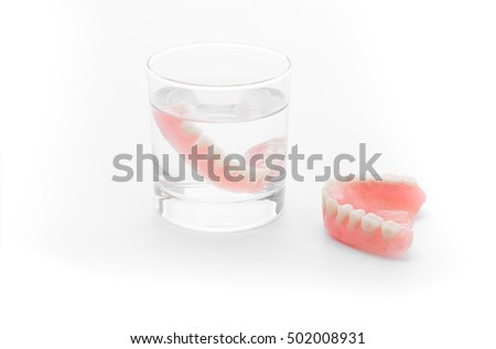 Full Denture in glass of water on white background #502008931