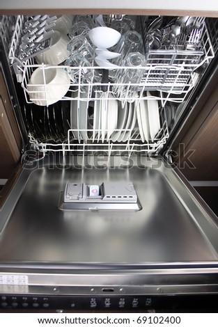 full dishwasher, focus on dishwasher detergent tablet