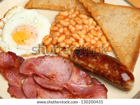 Full English breakfast with bacon, sausage, egg, baked beans and fried bread.