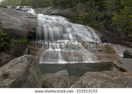 Full flowing waterfall in Spring