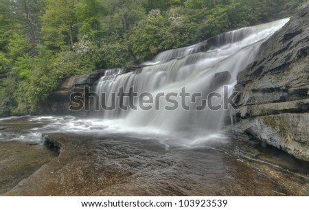 Full flowing waterfall in Spring