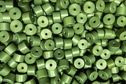 full frame batch of aluminium cylinder parts after anodizing with filling in green chromate solutions