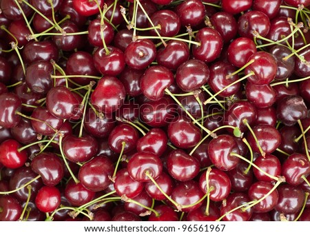 full frame, close up image of cherries on display at a Farmer's Market