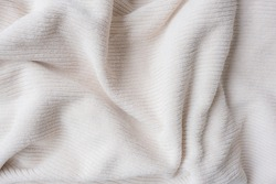 Full frame closeup of beige towel with soft filter effect - background concept