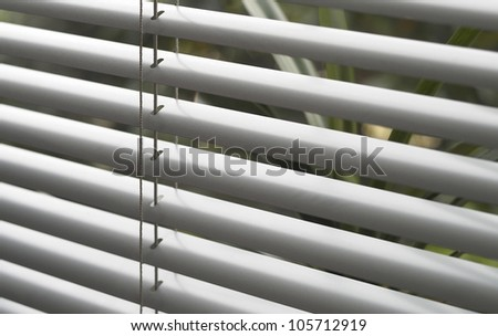 full frame detail of a grey window blind