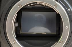 Full-frame 35mm 46 megapixel  sensor and the metal mount of a modern DSLR camera close up photograph,