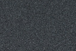 Full frame of black sandpaper texture. Abrasive material with a gritty surface