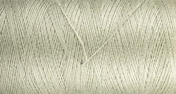Full frame of celeste color thread as background. The texture of the thread on the spool.