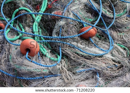 full frame of colourful fishing nets and rope