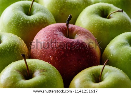 full frame of water drops on green and red apples backdrop