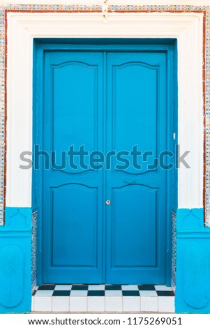 full frame shot of a traditional moroccan door painted in blue - Asilah, Morocco #1175269051