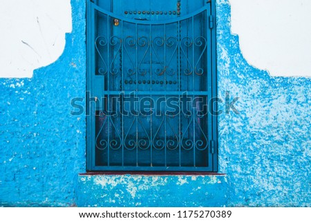 full frame shot of a traditional moroccan door painted in blue - Asilah, Morocco #1175270389