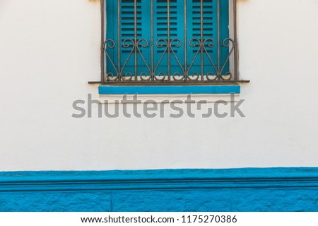 full frame shot of a traditional moroccan window painted in blue - Asilah, Morocco #1175270386