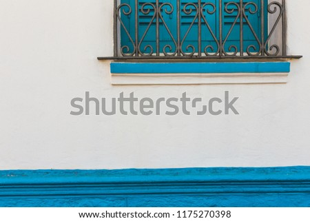 full frame shot of a traditional moroccan window painted in blue - Asilah, Morocco #1175270398