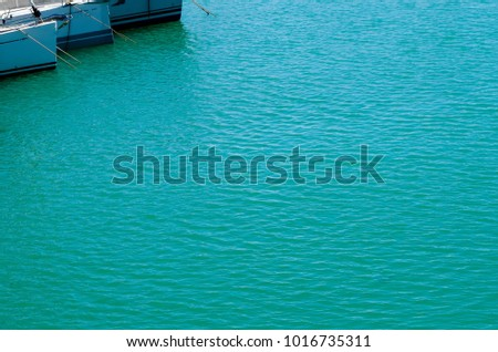 Full frame shot of basin with blue water and nautical vessels in Marina di Pisa, Province of Pisa, Tuscany, Italy in summer. #1016735311