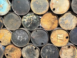 Full frame shot of many metal barrels stack