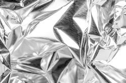 Full frame take of a sheeT of crumpled aluminum foil