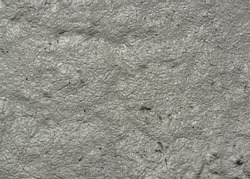 full frame wet grey muddy background