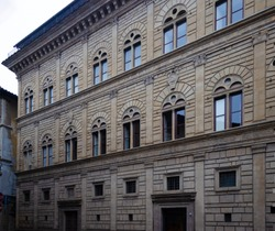 Full front facade of beautiful Palazzo Rucellai typical old renaissance palace in Florence Tuscany Italy