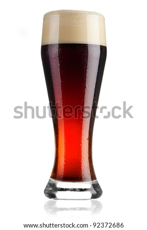 Full glass of cold dark beer on white background