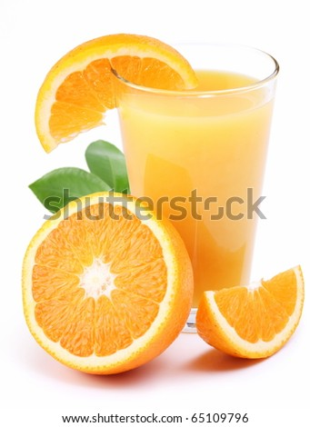 Full glass of fresh orange juice and fruit slice near it. Isolated on a white.