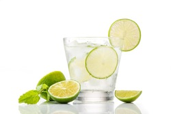 Full glass of water with lemon and mint isolated on white background