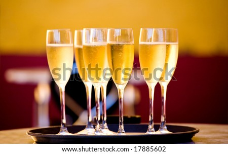 Full glasses of Champagne on tray
