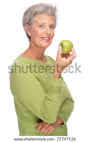 Full isolated portrait of a active senior with apple
