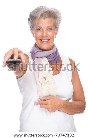 Full isolated portrait of a senior woman with remote control - stock photo