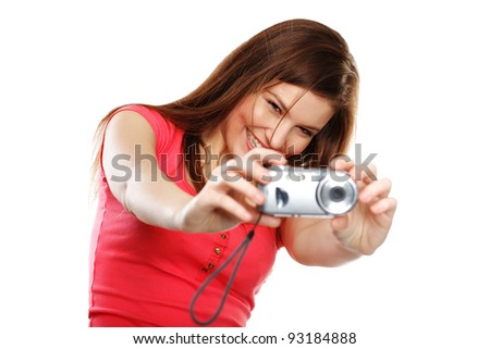 Full isolated studio picture from a young and beautiful woman with camera