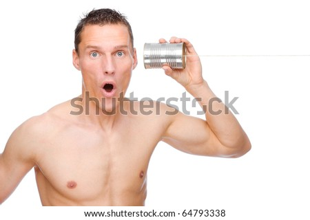 Full isolated studio picture from a young and happy man with tin phone