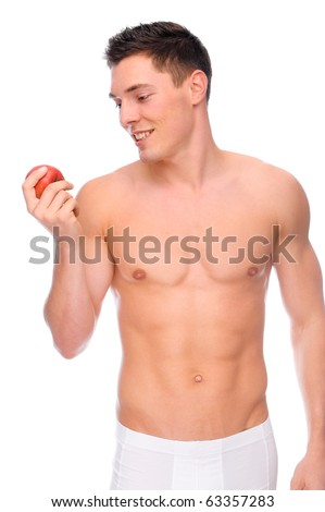 Full isolated studio picture from a young naked man with underwear an apple