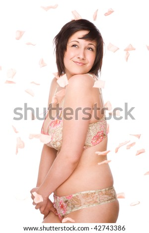 Full isolated studio picture from a young woman with falling flowers