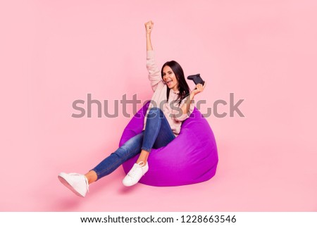 Full legs body size leisure lifestyle lady with her raised fist up she wear in trendy denim jeans urban outfit style stylish pullover sweatshirt shoes sit isolated on vivid pink background