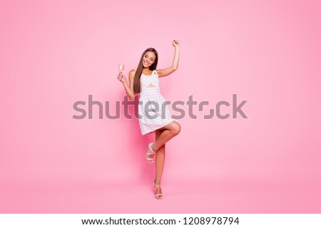 Full legs body size portrait of careless carefree chill lady she hold beverage in hand stand on her sharp pumps stilettos isolated on pink pastel shine background in white spring summer striped dress