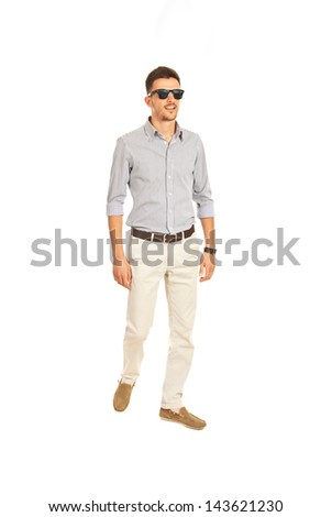 Full lenght of modern business man with sunglasses walking isolated on white backgorund