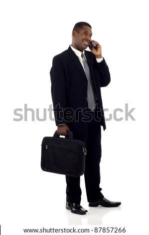 Full length a happy black businessman talking on the mobile phone isolated over white background