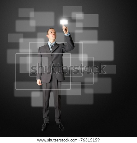 full length asian businessman push the button on virtual touch pad