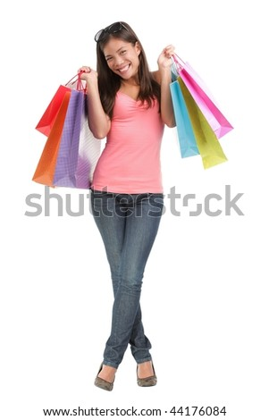Full length attractive shopping girl excited about her purchases. Isolated on white background.
