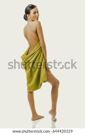 Full length back view woman wrapped in towel #644420329
