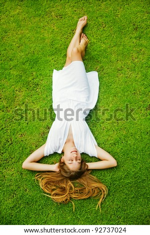Full-length beautiful woman on the grass