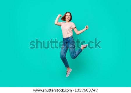 Full length body size photo beautiful amazing her she lady jumping high yell scream shout unexpected success short hairdo wear casual jeans denim pastel t-shirt isolated teal turquoise background