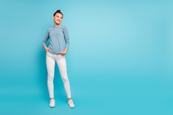 Full length body size photo beautiful amazing she her lady stylish hairstyle look side empty space wondered toothy funky wear casual white pants sweater pullover isolated blue bright background
